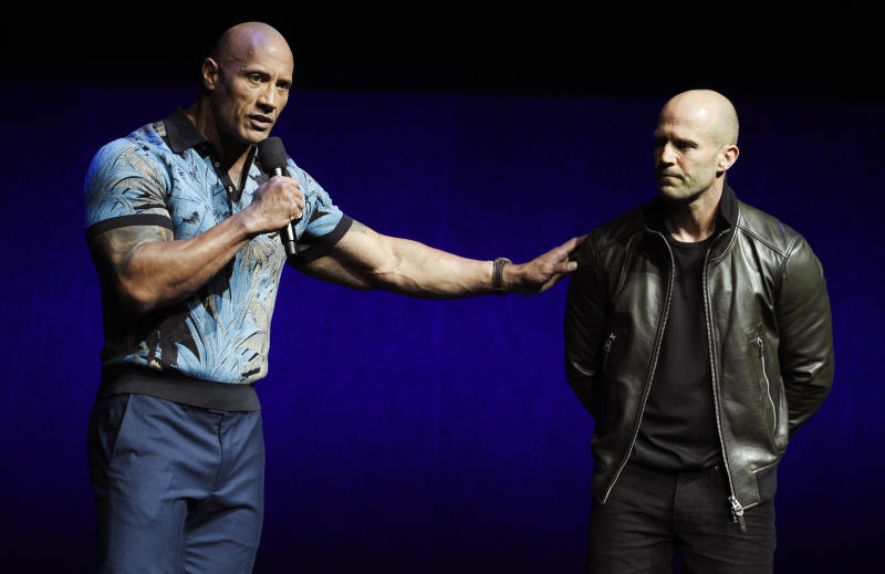 "Dwayne Johnson, left, and Jason Statham, cast members in the upcoming film ""Fast and Furious Presents: Hobbs & Shaw,"" appear during the Universal Pictures presentation at CinemaCon 2019, the official convention of the National Association of Theatre Owners (NATO) at Caesars Palace, Wednesday, April 3, 2019, in Las Vegas. (Photo by Chris Pizzello/Invision/AP)"