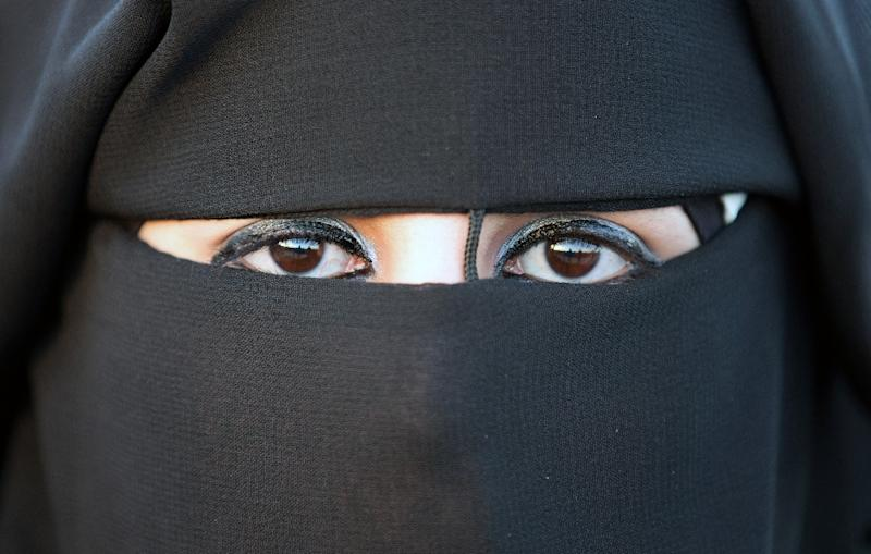 The Philippine president's mayor daughter says women in burqas and those wearing surgical masks should refrain from concealing their faces in public (AFP Photo/Menahem Kahana)