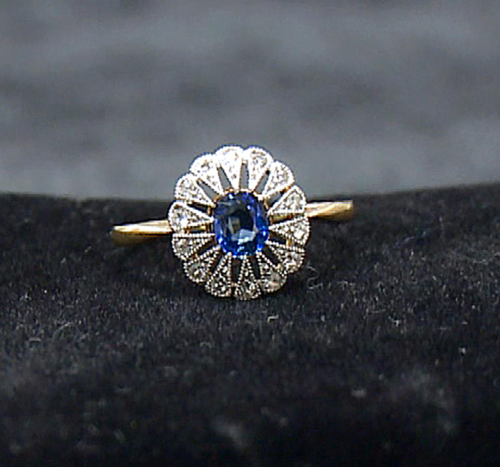 A diamond and sapphire ring recovered from the Titanic is seen in an image made from video. This piece and others begin a three-city tour in Atlanta on Friday, Nov. 16, 2012 and represent the largest collection of jewelry ever on display marking the 100th anniversary of the sinking of the ship. Although single pieces of jewelry have been on display at one or more permanent and traveling exhibits sponsored by Premier Exhibitions Inc., their Atlanta debut is the first time the majority of the collection has been available to the public. (AP Photo/Johnny Clark)