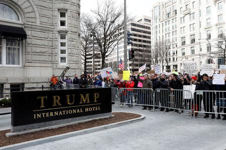 FILE PHOTO - Activists gather outside the Trump International Hotel to protest President Donald Trump's executive actions on immigration in Washington, DC, U.S. on January 29, 2017.  REUTERS/Aaron P. Bernstein/File Photo