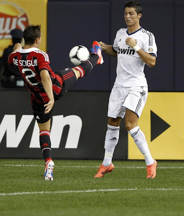 NEW YORK - AUGUST 08: Mattia De Sciglio #2 of A.C. Milan kicks the ball in front of Cristiano Ronaldo #7 of Real Madrid during their match at Yankee Stadium on August 8, 2012 in New York City. (Photo by Jeff Zelevansky/Getty Images)