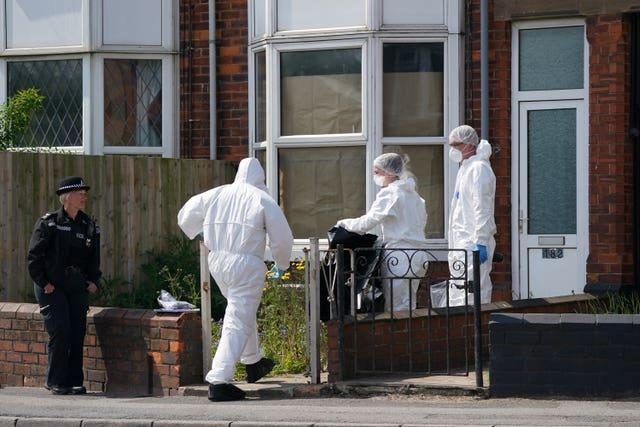 Police officers at the scene in High Holme Road, Louth, Lincolnshire, (Joe Giddens/PA)