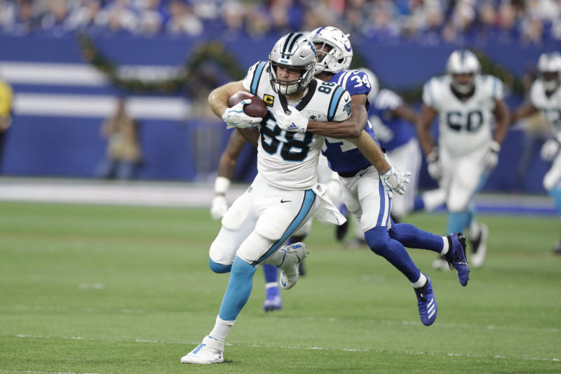 Carolina Panthers' Greg Olsen (88) is tackled by Indianapolis Colts' Rock Ya-Sin (34) during the first half of an NFL football game, Sunday, Dec. 22, 2019, in Indianapolis. (AP Photo/Michael Conroy)