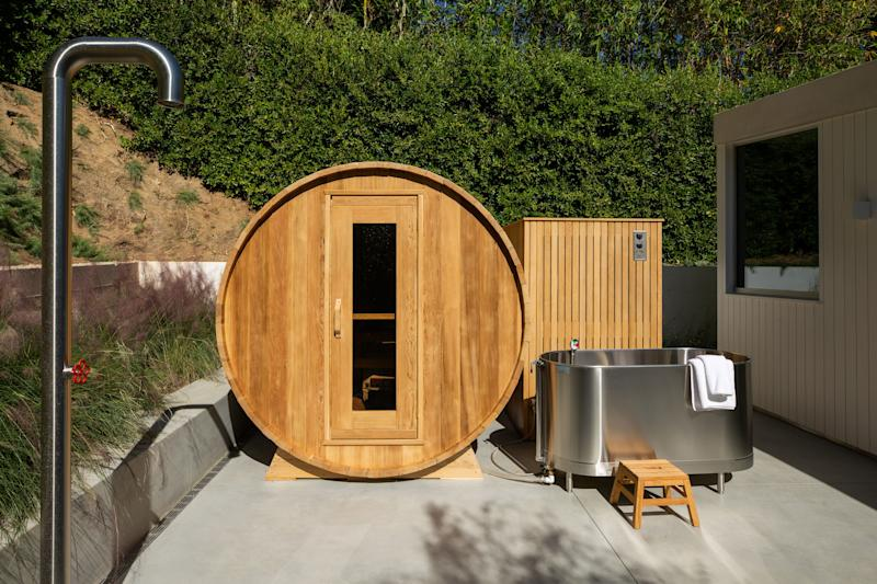 One of the roles this home served was as Statham's gym. Outside, there is an outdoor shower, a sauna from Nordic Sauna, a Whitehall Manufacturing 110-gallon sports whirlpool, and Hoshiazaki ice maker that he used for his ice baths.