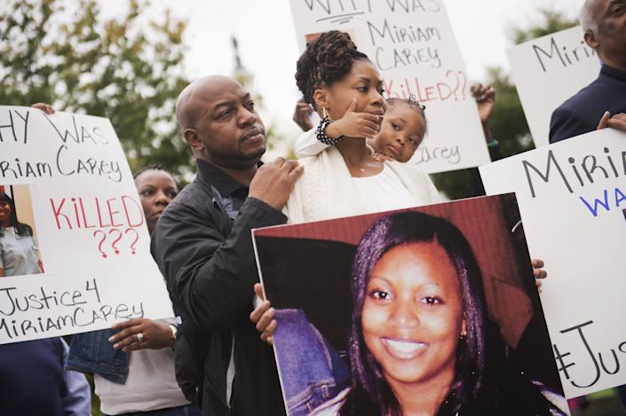 """U.S. Secret Service and Capitol Police officers fatally shot Miriam Carey in a car chase after she drove her car into a security checkpoint near the White House despite orders to stop. Officers fired multiple shots at Carey, a dental hygienist from Connecticut, <a href=""""http://www.huffingtonpost.com/2014/04/08/miriam-carey-autopsy-dc-chase_n_5109397.html"""" rel=""""nofollow noopener"""" target=""""_blank"""" data-ylk=""""slk:hitting her five times"""" class=""""link rapid-noclick-resp"""">hitting her five times</a>.&nbsp;Her 1-year-old daughter, who was also in the car, survived.<br><br>An autopsy found that Carey was not under the influence of drugs or alcohol, her family's attorney said, and no weapons were found in her car. She had previously been diagnosed with <a href=""""http://www.huffingtonpost.com/2014/04/08/miriam-carey-autopsy-dc-chase_n_5109397.html"""" rel=""""nofollow noopener"""" target=""""_blank"""" data-ylk=""""slk:postpartum depression and psychosis"""" class=""""link rapid-noclick-resp"""">postpartum depression and psychosis</a>.<br><br>Federal prosecutors said in 2014 that they <a href=""""http://www.huffingtonpost.com/2014/07/10/miriam-carey-shooting-investigation_n_5575043.html"""" rel=""""nofollow noopener"""" target=""""_blank"""" data-ylk=""""slk:would not file charges"""" class=""""link rapid-noclick-resp"""">would not file charges</a> against the officers. Carey&rsquo;s family filed a wrongful death lawsuit.<br><br>&ldquo;<a href=""""http://www.washingtonpost.com/sf/style/2014/11/26/how-miriam-careys-u-turn-at-a-white-house-checkpoint-led-to-her-death"""" rel=""""nofollow noopener"""" target=""""_blank"""" data-ylk=""""slk:The emphasis shouldn&rsquo;t be on why [Miriam was in Washington, D.C.]"""" class=""""link rapid-noclick-resp"""">The emphasis shouldn&rsquo;t be on why [Miriam was in Washington, D.C.]</a>,"""" sister Valarie Carey told The Washington Post last year. """"The emphasis should be [on] what those officers did. Were their actions proper?&rdquo;"""