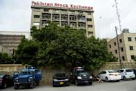 Police vehicles are seen in front of the Pakistan Stock Exchange building following a deadly attack by separatists from Balochistan province