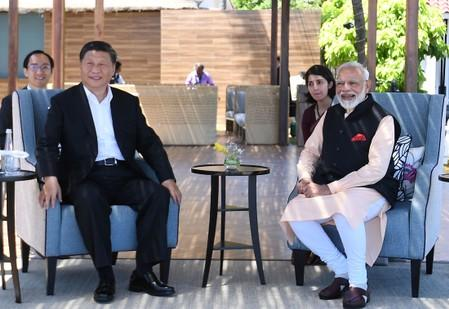 India's Prime Minister Modi and China's President Xi look on during their meeting in Mamallapuram