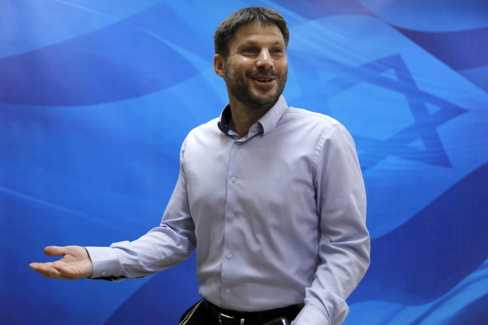 FILE - In this June 24, 2019, file photo, Bezalel Smotrich, the then Israeli transportation minister, arrives to attend a weekly cabinet meeting in Jerusalem. An alliance of far-right groups including openly racist and homophobic candidates like Smotrich appears poised to enter Israel's parliament, possibly as an indispensable member of Prime Minister Benjamin Netanyahu's right-wing coalition, according to exit polls Tuesday, March 23, 2021. Smotrich, a longtime activist, has organized anti-gay protests and recently compared gay marriage to incest. (Menahem Kahana/Pool via AP, File)