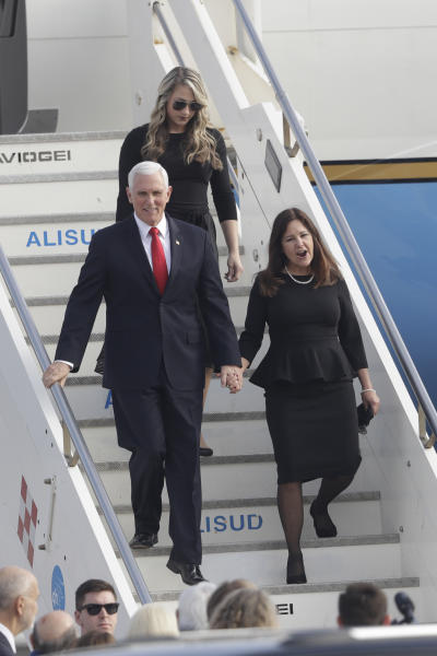 U.S. Vice President Mike Pence and his wife Karen hold hands as they disembark from Air Force Two upon their arrival at Rome's Ciampino airport, Friday, Jan. 24, 2020. Pence is scheduled to meet later with Pope Francis at the Vatican. (AP Photo/Gregorio Borgia)