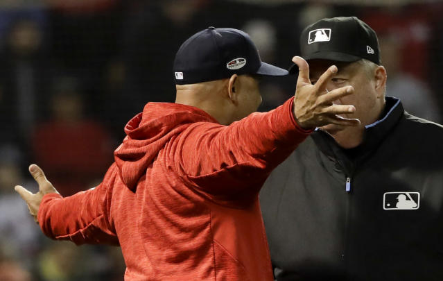 Boston Red Sox manager Alex Cora argues a strike three call with umpire Joe West during the fifth inning in Game 1 of a baseball American League Championship Series against the Houston Astros on Saturday, Oct. 13, 2018, in Boston. (AP Photo/David J. Phillip)