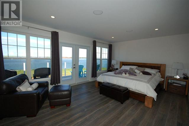 <p><span>296 Macmillan Point Road, West Covehead, P.E.I.</span><br> There are five bedrooms, and the master has a balcony overlooking the water.<br> (Photo: Zoocasa) </p>