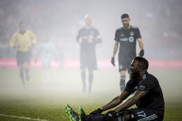 Toronto FC forward Jozy Altidore (17) recovers on the ground after being tackled during the second half against Minnesota United during an MLS soccer match in Toronto on Friday, April 19, 2019.(Christopher Katsarov/The Canadian Press via AP)