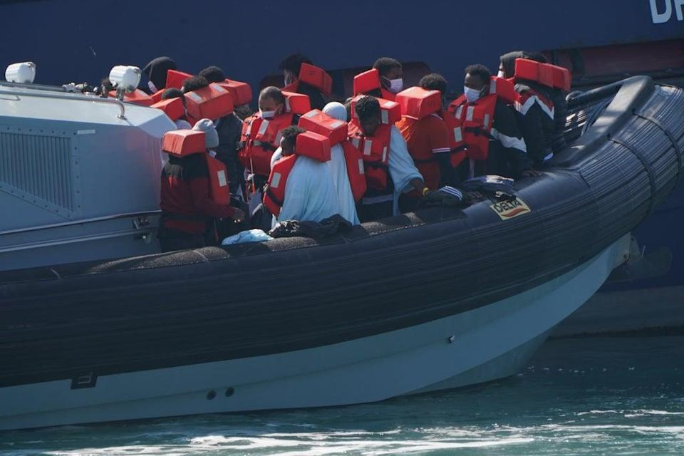 A group of people thought to be migrants are brought in to Dover ((Jonathan Brady/PA) (PA Wire)