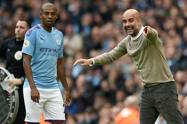 Pep Guardiola (right), Fernandinho and Manchester City are already eight points off the top of the Premier League table. What's gone wrong? (Getty)