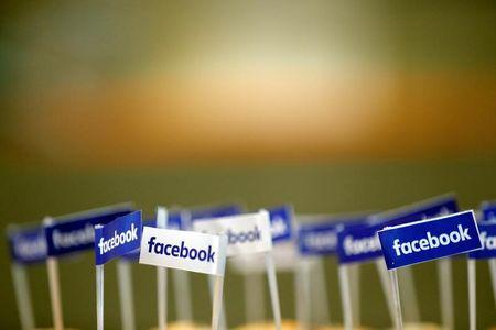 Miniature Facebook banners are seen on snacks prepared for the visit by Facebook's Chief Operating Officer in Paris, France, January 17, 2017.  REUTERS/Philippe Wojazer