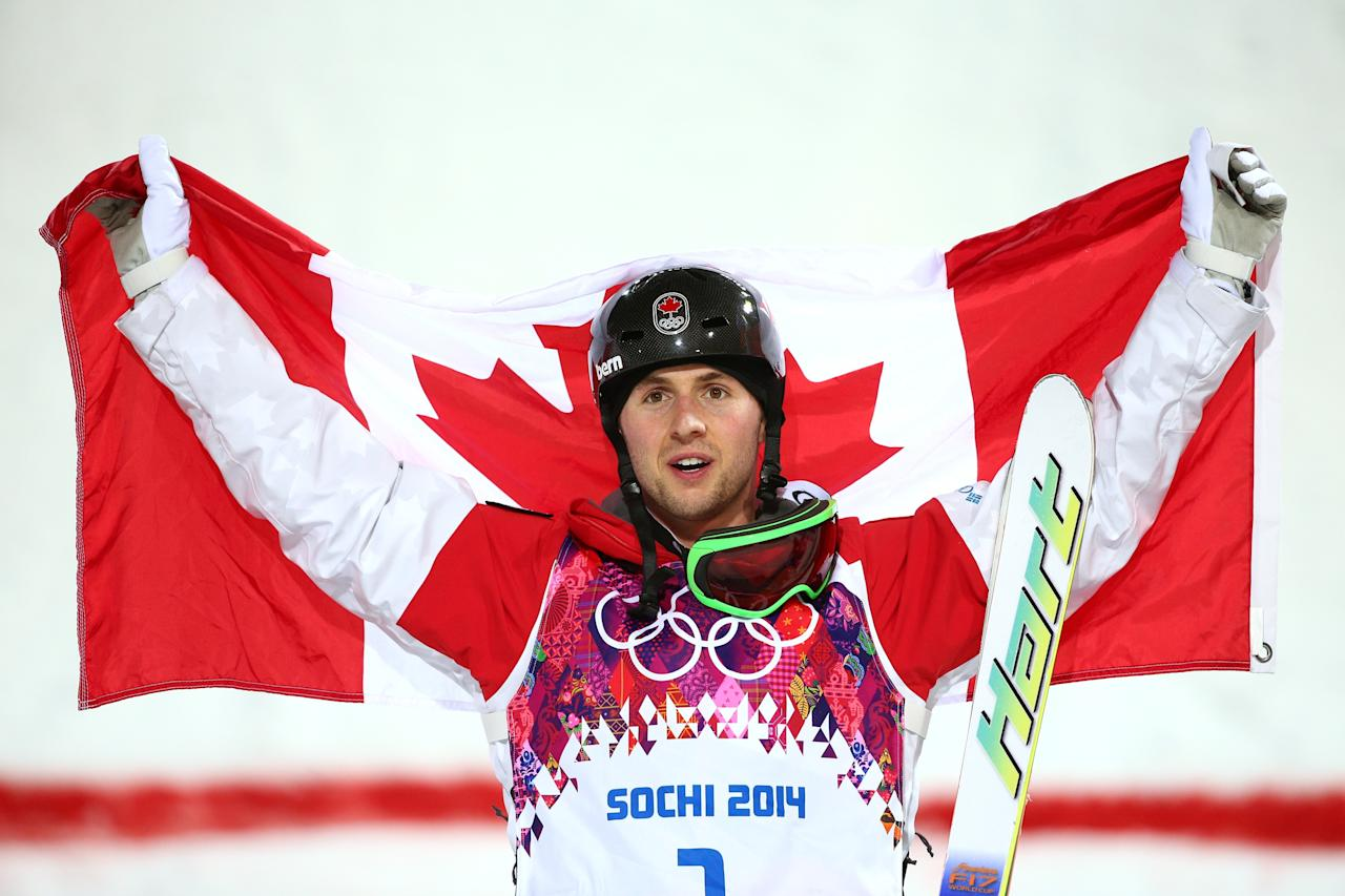 SOCHI, RUSSIA - FEBRUARY 10: Gold medalist Alex Bilodeau of Canada celebrates during the flower ceremony for the Men's Moguls Finals on day three of the Sochi 2014 Winter Olympics at Rosa Khutor Extreme Park on February 10, 2014 in Sochi, Russia. (Photo by Cameron Spencer/Getty Images)