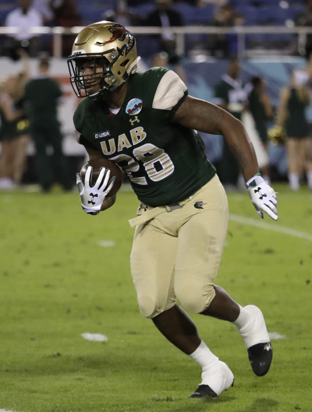 FILE - In this Dec. 18, 2018, file photo, UAB running back Spencer Brown (28) carries during the first half of the Boca Raton Bowl NCAA college football game against Northern Illinois in Boca Raton, Fla. Brown has had consecutive 1,200-yard seasons. He ran for 1,227 yards (87.6 per game) with 16 TDs last year. (AP Photo/Lynne Sladky, File)