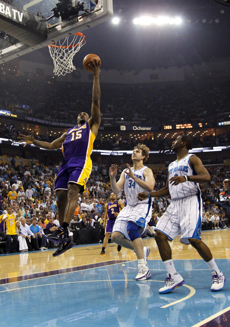 Los Angeles Lakers forward Ron Artest (15) drives to the basket in front of New Orleans Hornets center Aaron Gray (34) and point guard Chris Paul (3) during the second quarter of game four of a first-round NBA basketball playoff series in New Orleans, Sunday, April 24, 2011. (AP Photo/Gerald Herbert)