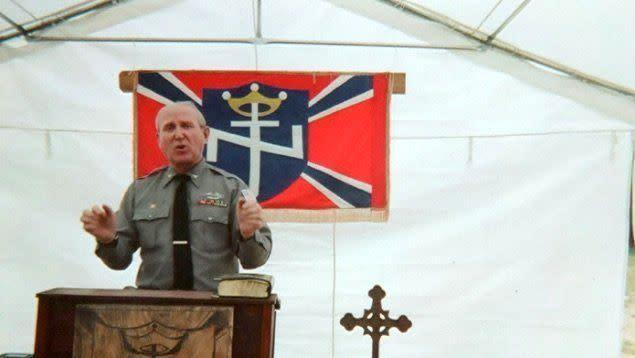 A photo from Arthur Jones' campaign website shows him speaking at the Aryan Nations 2014 World Congress in Converse, Louisiana.