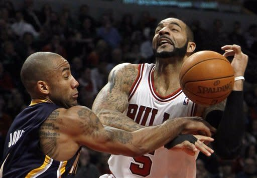 Indiana Pacers guard Dahntay Jones, left, fouls Chicago Bulls forward Carlos Boozer, during the first half of an NBA basketball game on Wednesday, Jan. 25, 2012, in Chicago. (AP Photo/Charles Rex Arbogast)