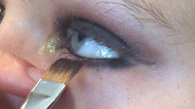 <p>At the Julien Macdonald Spring 2017 show, MAC makeup artist Val Garland dusted a classic black smoky eye with golden shimmer, concentrating it in the inner corner of the eye for a small, gilded pop.</p>