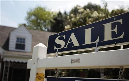 A 'sale' sign is seen outside a house in Alexandria, Virginia