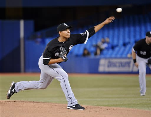 Chicago White Sox starting pitcher Jose Quintana throws against the Toronto Blue Jays during the first inning of a baseball game in Toronto on Wednesday April 17, 2013. (AP Photo/The Canadian Press, Nathan Denette)