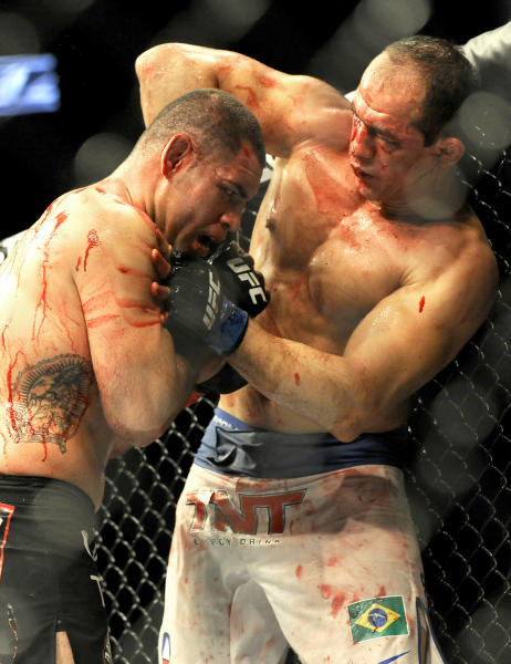 UFC heavyweight champion Cain Velasquez and former heavyweight champion Junior Dos Santos fight for the UFC World Heavyweight title in Houston, Saturday, Oct. 19, 2013. Velasquez kept his title, beating Santos with a TKO in the fifth round. (AP Photo/Pat Sullivan)