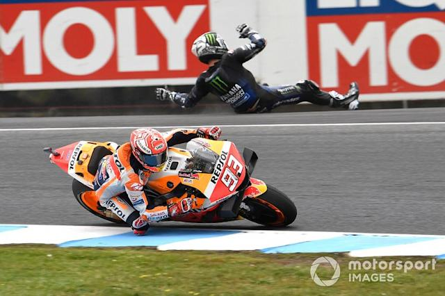 "Marc Marquez, Repsol Honda Team, Maverick Vinales, Yamaha Factory Racing crashing in the background <span class=""copyright"">Gold and Goose / Motorsport Images</span>"