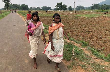 Members of the Dongria Kondh tribe leave after attending a protest rally demanding the ouster of a Vedanta Limited alumina plant in Lanjigarh in the eastern state of Odisha, India, June 5, 2018. Picture taken June 5, 2018. REUTERS/Krishna N. Das