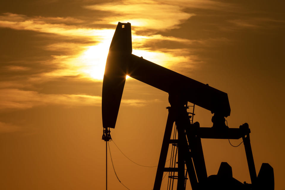 FILE - In this April 21, 2021, file photo the sun sets beyond a pumpjack near Goldsmith, Texas. Congressional Democrats have approved a measure reinstating rules aimed at limiting climate-warming greenhouse gas emissions from oil and gas drilling. The House gave final legislative approval Friday, June 25, to a resolution that would undo a Trump-era environmental rule that relaxed requirements of a 2016 Obama administration rule targeting methane emissions from oil and gas drilling. (Eli Hartman/Odessa American via AP, File)