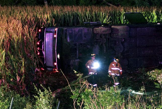 Officials work the scene of an overturned Greyhound bus on interstate I-75 in Liberty Township, Ohio on Saturday, Sept. 14, 2013. Authorities say that at least 34 people have been hurt, with injuries ranging from minor to severe. (AP Photo/Dayton Daily News, Nick Daggy)