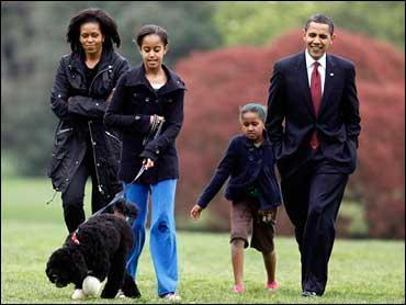 Malia Obama walks with new dog Bo, followed by President Barack Obama, Sasha Obama and first lady Michelle Obama on the South Lawn at the White House in Washington, Tuesday, April 14, 2009. (AP Photo./Charles Dharapak / Credit: AP Photo/Charles Dharapak