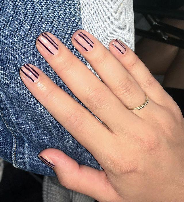 """<p>Choose one color, then add some nail tape to get clean lines for this manicure.</p><p><a href=""""https://www.instagram.com/p/BYoc_GphuKj/&hidecaption=true"""" rel=""""nofollow noopener"""" target=""""_blank"""" data-ylk=""""slk:See the original post on Instagram"""" class=""""link rapid-noclick-resp"""">See the original post on Instagram</a></p>"""