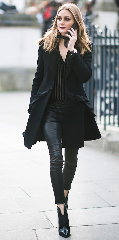 <p>Palermo took London Fashion Week by storm in a ruffled coat, sheer striped top, and leather leggings. She polished off the chic look with a neck scarf and black booties.</p>