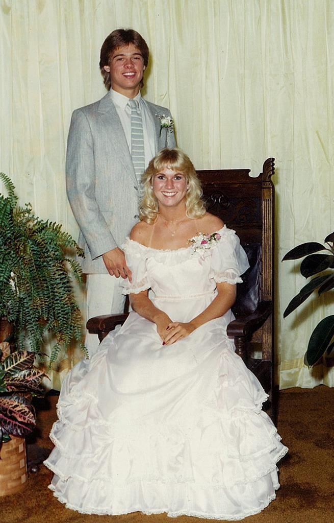 <p>Long before Jennifer Aniston and Angelina Jolie, Brad Pitt's heart belonged to Tonya Westphalen. The <i>Moneyball</i> star — who graduated from Kickapoo High School in Springfield, Mo., in 1982 — suited up to take his pretty girlfriend with some serious tan lines to prom. We can see why Pitt was voted best-dressed male in his class. <i>(Photo: Splash News)</i></p>
