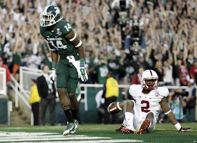 Michigan State wide receiver Tony Lippett celebrates his touchdown past Stanford cornerback Wayne Lyons, during the second half of the Rose Bowl NCAA college football game on Wednesday, Jan. 1, 2014, in Pasadena, Calif. (AP Photo/Jae C. Hong)