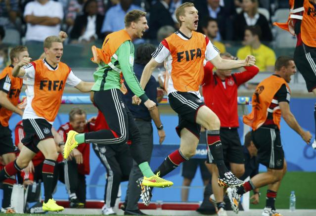 Germany's substitute goalkeeper Ron-Robert Zieler (in green) and his teammates celebrate after Toni Kroos (unseen) scored the team's third goal during their 2014 World Cup semi-finals against Brazil at the Mineirao stadium in Belo Horizonte July 8, 2014. REUTERS/Ruben Sprich (BRAZIL - Tags: SOCCER SPORT WORLD CUP)