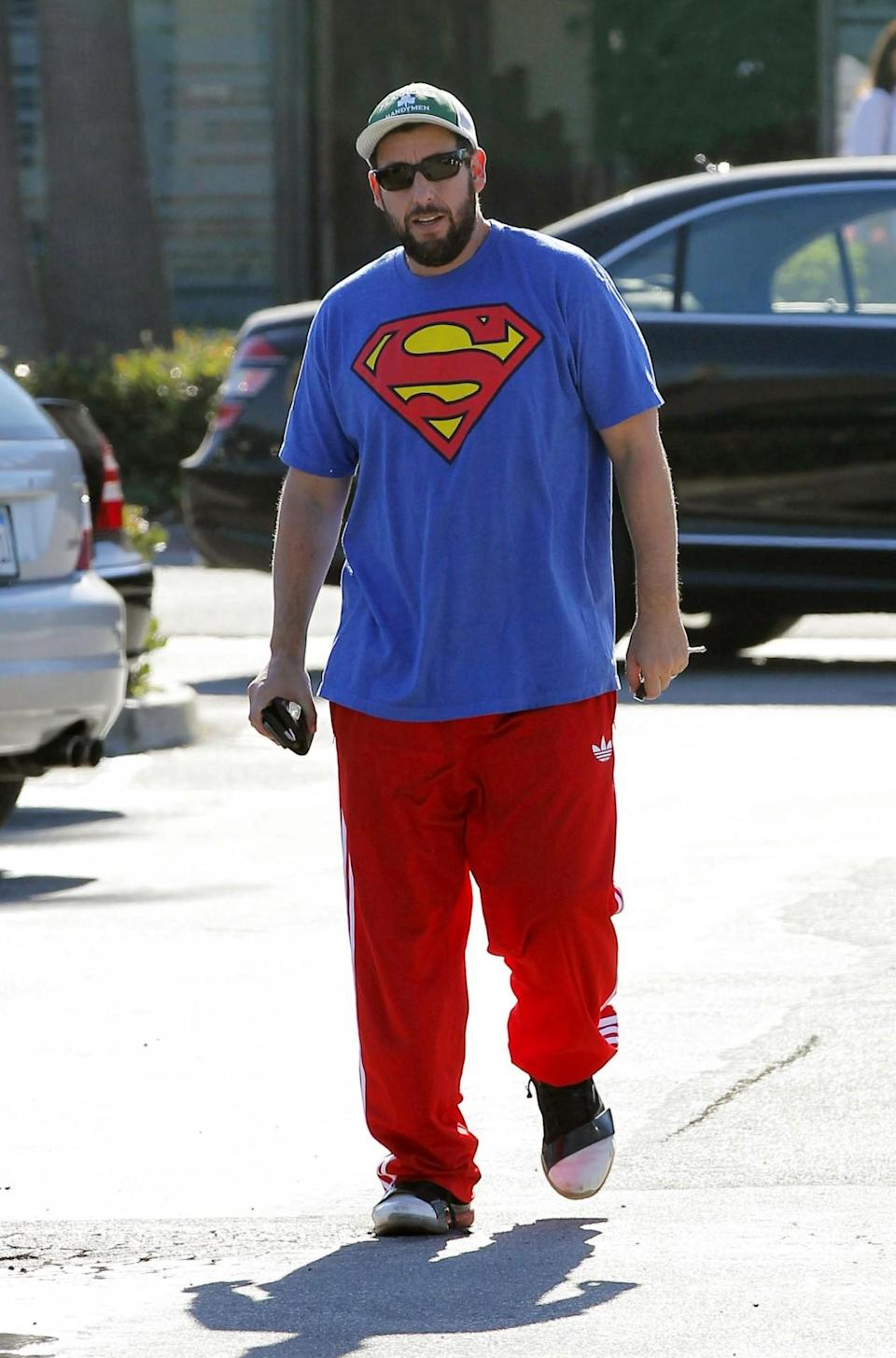 <p>It's a bird, it's a plane … it's Adam Sandler in a Superman T-shirt – and track pants. (Photo by Bauer-Griffin/GC Images)</p>