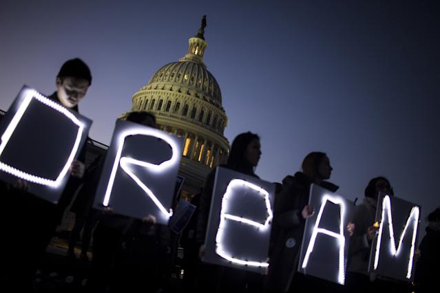 <p>Demonstrators hold illuminated signs during a rally supporting the Deferred Action for Childhood Arrivals program (DACA), or the Dream Act, outside the U.S. Capitol building in Washington, D.C., on Thursday, Jan. 18, 2018. (Photo: Zach Gibson/Bloomberg via Getty Images) </p>