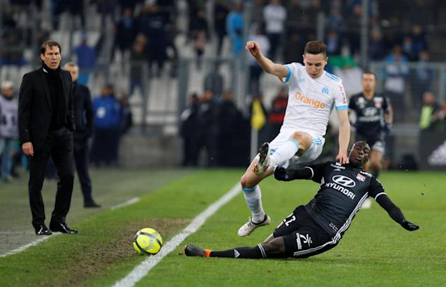 Soccer Football - Ligue 1 - Olympique de Marseille vs Olympique Lyonnais - Orange Velodrome, Marseille, France - March 18, 2018 Lyon's Ferland Mendy in action with Marseille's Florian Thauvin REUTERS/Philippe Laurenson