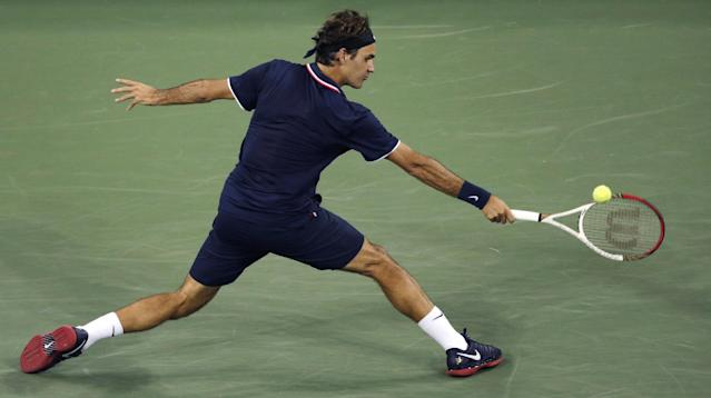 Roger Federer, of Switzerland, stretches for a return to Tomas Berdych, of the Czech Republic, during a quarterfinal at the U.S. Open tennis tournament, Wednesday, Sept. 5, 2012, in New York. (AP Photo/Charles Krupa)