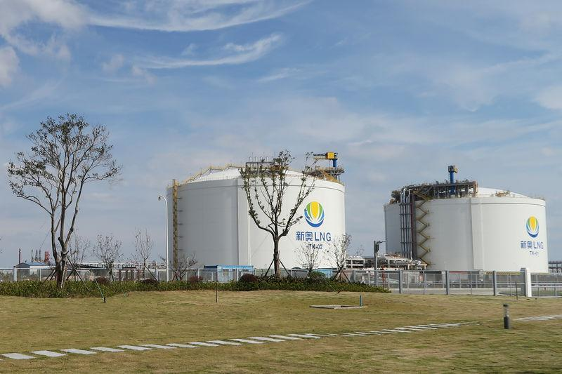 FILE PHOTO: Liquefied natural gas (LNG) storage tanks are seen at ENN's LNG import terminal in Zhoushan, Zhejiang