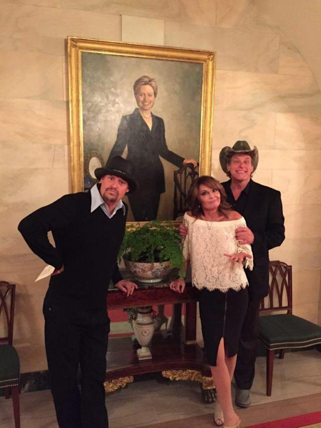 Kid Rock, Sarah Palin, and Ted Nugent couldn't resist posing with this portrait of Hillary Clinton. (Photo: SarahPalin.com)