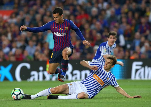 Soccer Football - La Liga Santander - FC Barcelona vs Real Sociedad - Camp Nou, Barcelona, Spain - May 20, 2018 Barcelona's Philippe Coutinho in action with Real Sociedad's Diego Llorente REUTERS/Albert Gea