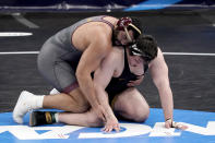 Minnesota's Gable Steveson, left, takes on Iowa's Tony Cassioppi during their 285-pound match in the semifinal round of the NCAA wrestling championships Friday, March 19, 2021, in St. Louis. (AP Photo/Jeff Roberson)
