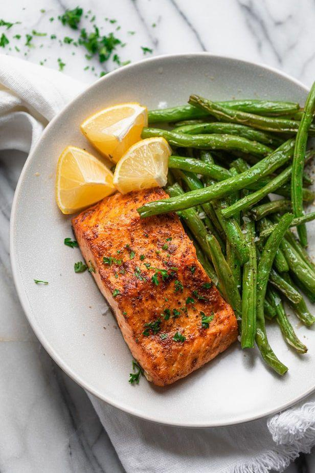 """<p>Yes, you can cook salmon right in your air fryer! This method takes just ten minutes, and you'll need only one tablespoon of olive oil for four six-ounce fillets. Serve with your favorite grains or veggies.</p><p><strong>Get the recipe at <a href=""""https://feelgoodfoodie.net/recipe/air-fryer-salmon/#wprm-recipe-container-17179"""" rel=""""nofollow noopener"""" target=""""_blank"""" data-ylk=""""slk:Feel Good Foodie"""" class=""""link rapid-noclick-resp"""">Feel Good Foodie</a>.</strong></p><p><a class=""""link rapid-noclick-resp"""" href=""""https://go.redirectingat.com?id=74968X1596630&url=https%3A%2F%2Fwww.walmart.com%2Fbrowse%2Fhome%2Fair-fryers%2F4044_90548_90546_4824_9960466&sref=https%3A%2F%2Fwww.thepioneerwoman.com%2Ffood-cooking%2Fmeals-menus%2Fg37023193%2Fsalmon-recipes%2F"""" rel=""""nofollow noopener"""" target=""""_blank"""" data-ylk=""""slk:SHOP AIR FRYERS"""">SHOP AIR FRYERS</a></p>"""