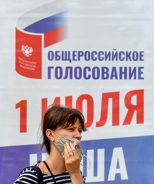 Polls suggest that most Russians see the constutional changes as a 'big plus' (AFP Photo/Yuri KADOBNOV)