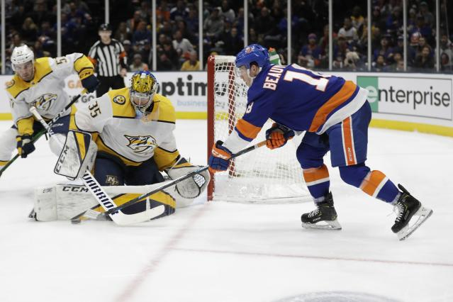 Nashville Predators goaltender Pekka Rinne (35) defends against New York Islanders' Anthony Beauvillier (18) during the second period of an NHL hockey game Tuesday, Dec. 17, 2019, in Uniondale, N.Y. (AP Photo/Frank Franklin II)