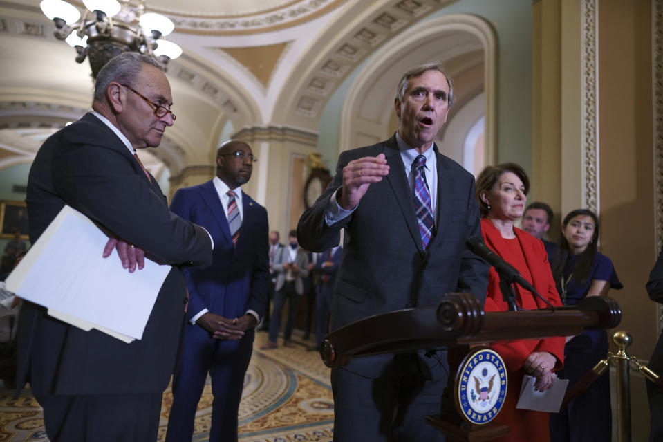 From left, Senate Majority Leader Chuck Schumer, D-N.Y., Sen. Raphael Warnock, D-Ga., Sen. Jeff Merkley, D-Ore., and Sen. Amy Klobuchar, D-Minn., meet with reporters before a key test vote on the For the People Act, a sweeping bill that would overhaul the election system and voting rights, at the Capitol in Washington, Tuesday, June 22, 2021. The bill is a top priority for Democrats seeking to ensure access to the polls and mail in ballots, but it is opposed by Republicans as a federal overreach. (AP Photo/J. Scott Applewhite)